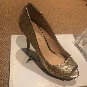 New in box gold Aldo heels